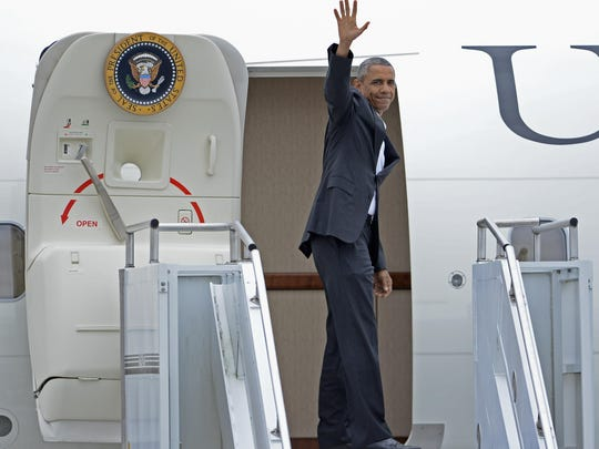 President Barack Obama waves as he boards Air Force One to depart Baton Rouge Washington Thursday.