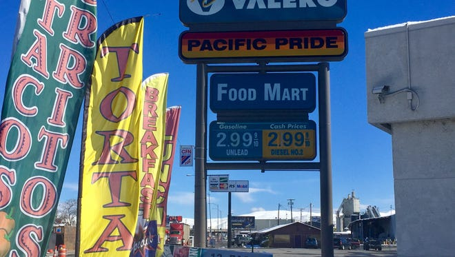 Fluttering flags hawk some of the menu items sold from Burrito Express in the Valero gas station food mart on East Fourth Street in Reno.