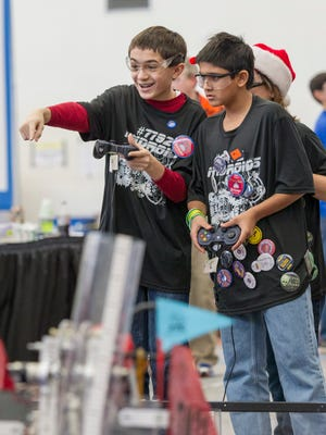 Sohan Desai (right) and Vikram Strander, 7th grade Lakeview students of team Nindroids, operate their robot at the Michigan State Championship FIRST Tech Challenge at Lakeview High School.