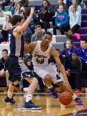 DaLeon Graham of Lakeview looks to drive past Jake Link of Loy Norrix in this SMAC East contest on Friday.