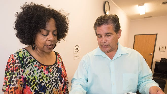 Invictus Knowledge Institute Executive Director, David Costales, right, reviews the requirements his organization's new technology programs with Pathways for Change Director of The Family Center Cheryl Perry Monday, Sept. 18, 2017. Invictus and Pathways are partnering together to offer education and training in information technology.