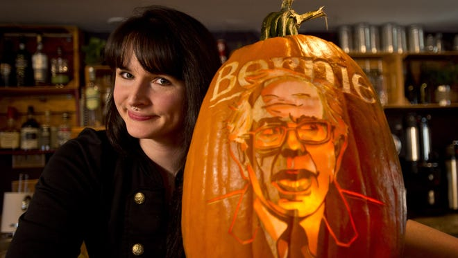 Ashley Campbell, designer, artist and co-owner of Rustic Root in Shelburne, Vt., carved an image of presidential candidate Bernie Sanders on a pumpkin displayed near the entrance of the restaurant.