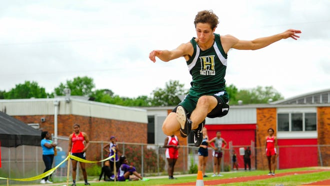 Chandler Mixon competing in the Long Jump at the LCA  7-1A district track meet at Northside High School. April 19, 2016