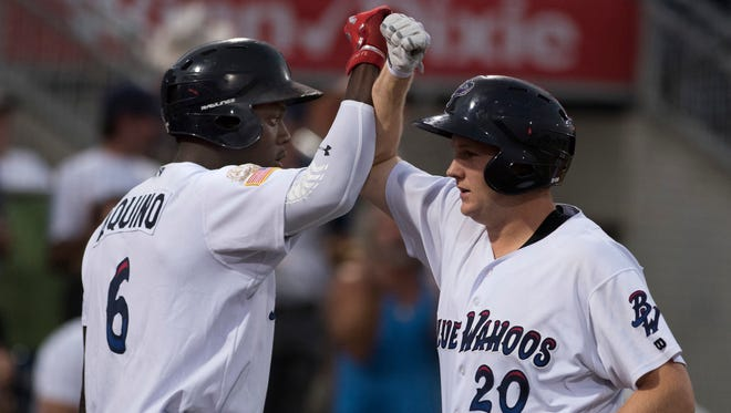 Blue Wahoos first baseman, Gavin LaValley, (No. 20, right, celebrates his two run homer with teammate, Aristides Aquino, ( No.6) during Thursday night's game two against the Jumbo Shrimp.