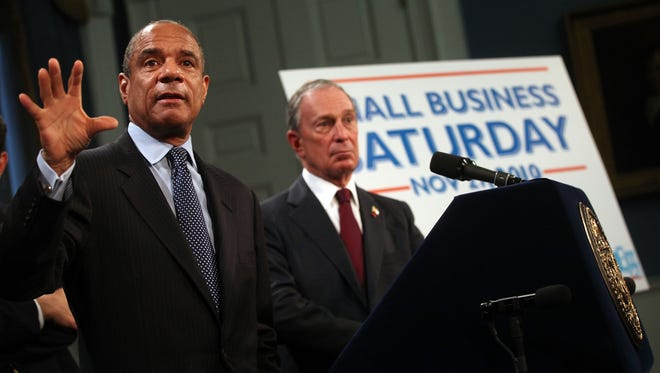 "American Express CEO Kenneth Chenault, left, and then-New York City Mayor Michael Bloomberg announce ""Small Business Saturday"" at City Hall on Nov. 8, 2010, in New York City."