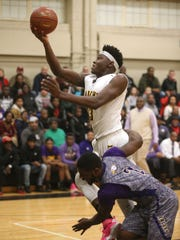 McQuaid's Isaiah Stewart is fouled by East's Cypher Campbell-Boller (2).