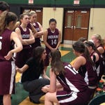 Southern Fulton coach Meagan Raville talks strategy with her team during a fourth-quarter timeout on Wednesday night. SF lost to James Buchanan, 50-48