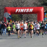 Runners begin the 2014 Tim Kennard 10 Mile River Run and 5K Run/Walk. Doug Mock of Ellicott City, Md., wearing No. 1, took home first place in the 10-mile run with a net time of 16:58.  Joey Gardner Photo 030214-KennardRun-JDG--Joey Gardner Photo--Runners begin the 2014 Tim Kennard 10 Mile River Run and 5K Run/Walk.  **********RUNNER #1 IN THE MIDDLE WEARING ORANGE IS THE TEN MILE WINNER*************