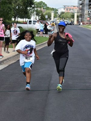 Participants at the inaugural Running for HER 5k in 2017.