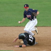 Stevens Point's Andy Tepp (7) leaps into the air as Marshfield's Jared Klein slides into second during the third day of the American Legion Regionals in Marshfield, July 21, 2016.