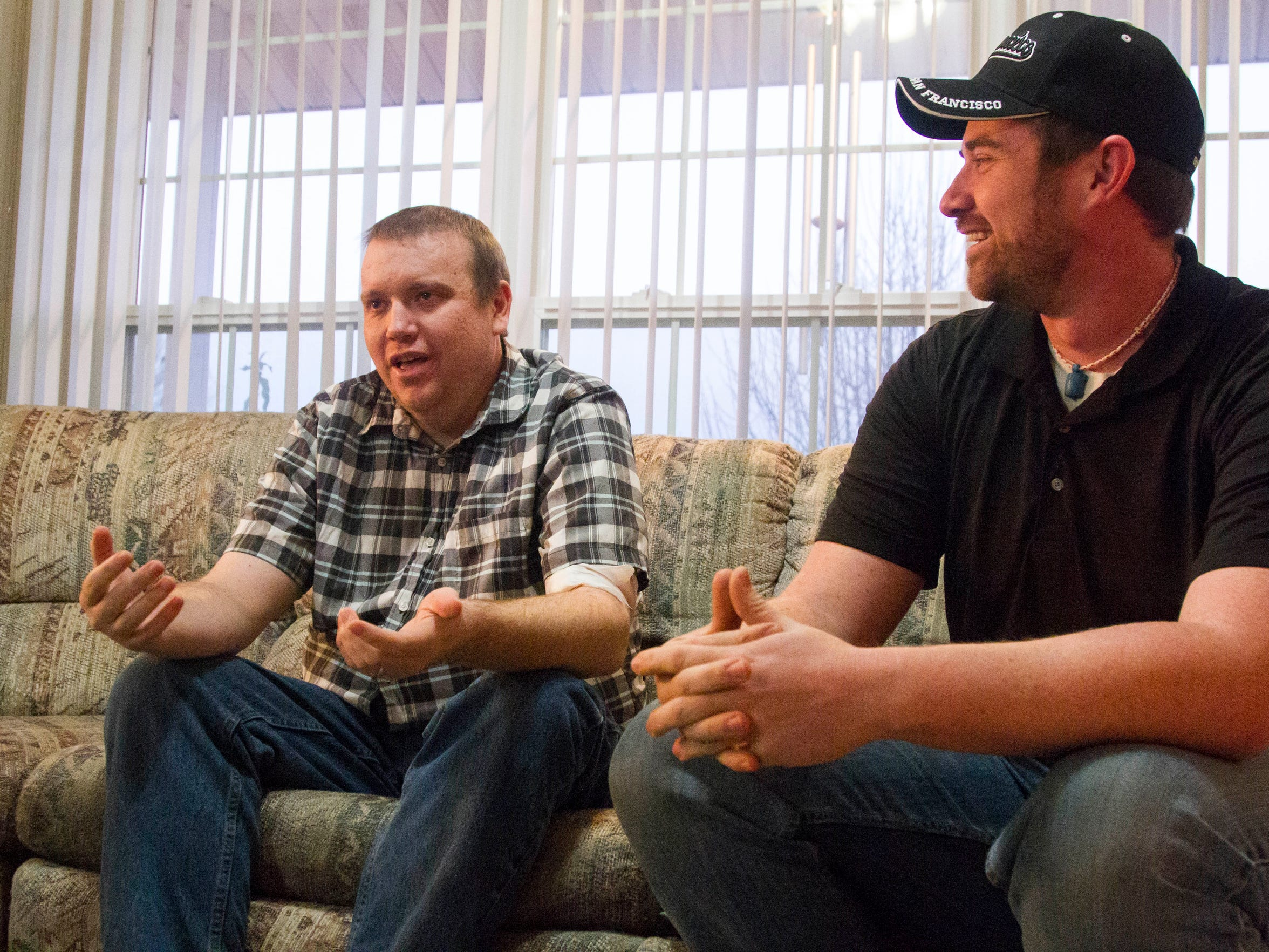 Brothers Eric (left) and Kyle (right) Stapley talk