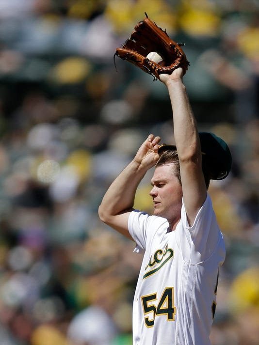 Oakland Athletics pitcher Sonny Gray removes his cap in the fifth inning of a baseball game against the Kansas City Royals, Saturday, April 16, 2016, in Oakland, Calif. (AP Photo/Ben Margot)