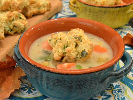 Chicken Pot Pie Soup is topped with cheddar drop biscuits.