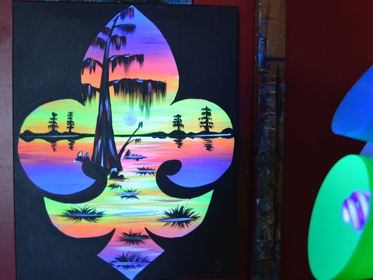 Black light painting offered at Painting with a Twist