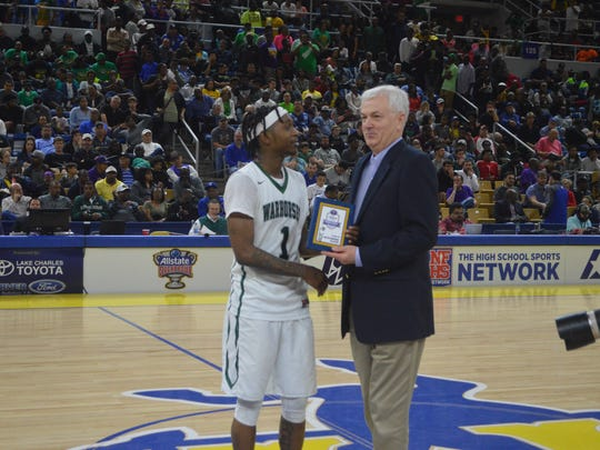 Peabody senior Cedric Russell (left) earned MVP honors for the Class 3A championship game.