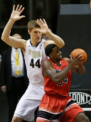 Gardner-Webb's Jerome Hill bumps his head on Isaac Haas' elbow as he drives to the basket Monday, December 22, 2014, at Mackey Arena on the campus of Purdue University. Gardner-Webb beat Purdue 89-84.