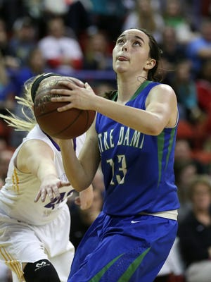 Green Bay Notre Dame's Katelyn Morgan (13) drives to the basket in the first half during Friday's WIAA Division 2 girls' state basketball game against New Berlin Eisenhower at the Resch Center in Ashwaubenon.