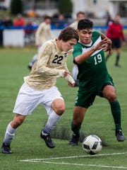 Salesianum's Casey Kurlej (No. 22) tries to work past Indian River's Arturo Mora Salas in the first half of Salesianum's 3-2 overtime win over Indian River High School at the Hockessin Soccer Club in Hockessin on Tuesday afternoon.