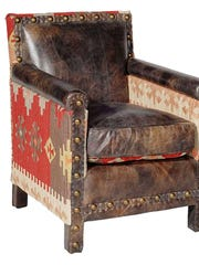Distressed leather, kilim upholstery and sparse nailhead trim make this traditional chair distinctive.
