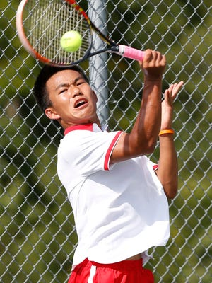 West Lafayette's Nathan Hu with a return to Daniel Zimpfer of Harrison at No. 2 singles Thursday, August 17, 2017, at Harrison High School. Hu won 6-4, 2-6, 6-4. West Lafayette won the match 4-1.
