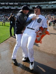 Tigers starting pitcher Matt Boyd, right, is congratulated by Warwick Saupold after Boyd's one-hitter against the White Sox, Sept. 17, 2017 in Detroit.