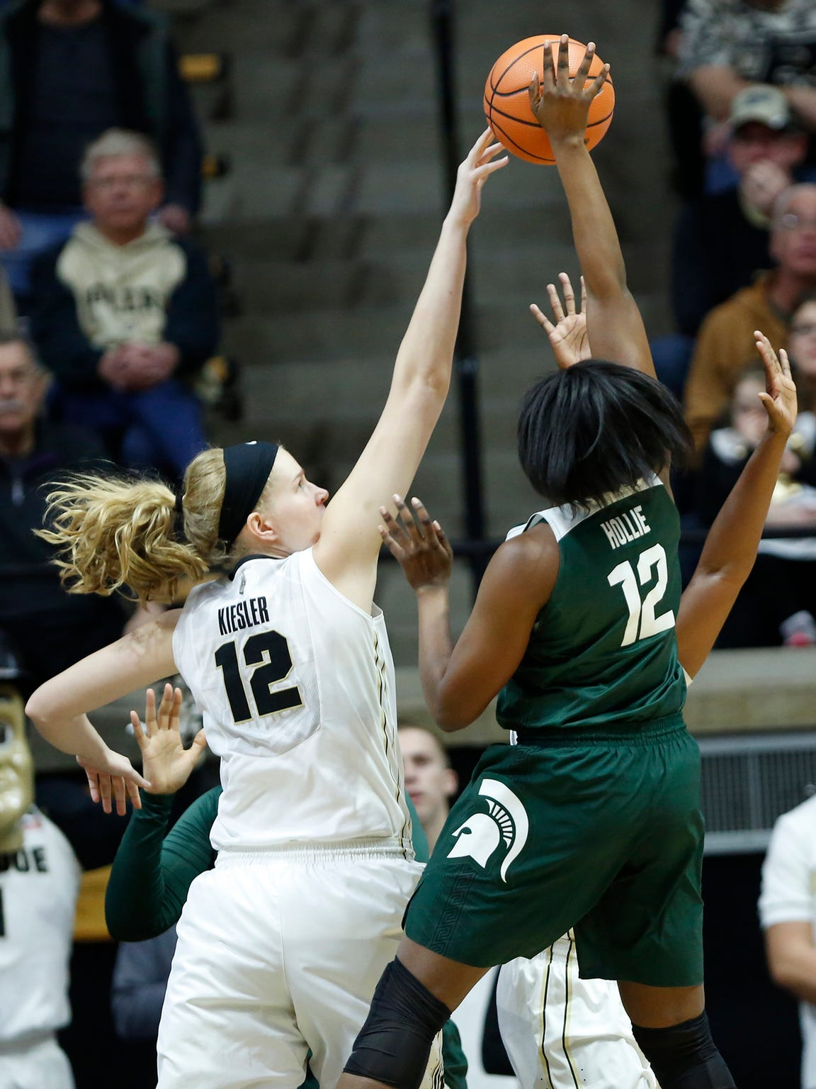 Nora Kiesler of Purdue blocks a shot by Nia Hollie of Michigan State Saturday, February 24, 2018, at Mackey Arena. Purdue fell to Michigan State 82-68.