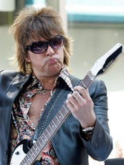 "Bon Jovi guitarist Richie Sambora performs with group on the NBC ""Today"" television program in New York's Rockefeller Center, Tuesday June 19, 2007.  (AP Photo/Richard Drew)"