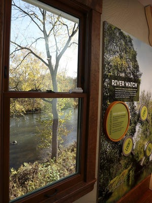 The Cuyahoga River is seen outside a window at the Boston Mill Visitor Center on Oct. 22 in Boston Township.