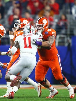 Ohio State's Jalyn Holmes rushes against Clemson offensive lineman Taylor Hearn on Dec. 31, 2016 in a College Football Playoff game.