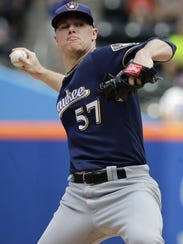 Milwaukee Brewers' Chase Anderson delivers a pitch