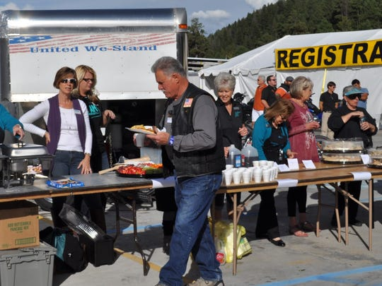 The Ruidoso Valley Chamber of Commerce Greeters and the chamber staff welcome and serve guests at locals night at the Golden Aspen Motorcycle Rally at Inn of the Mountain Gods Wednesday.