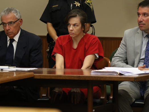 Laura Rideout, sitting between her two attorneys Michael