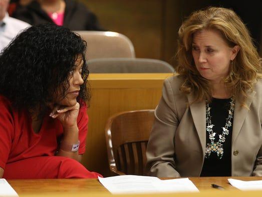 Judge Leticia Astacio confers with Bridget Field after
