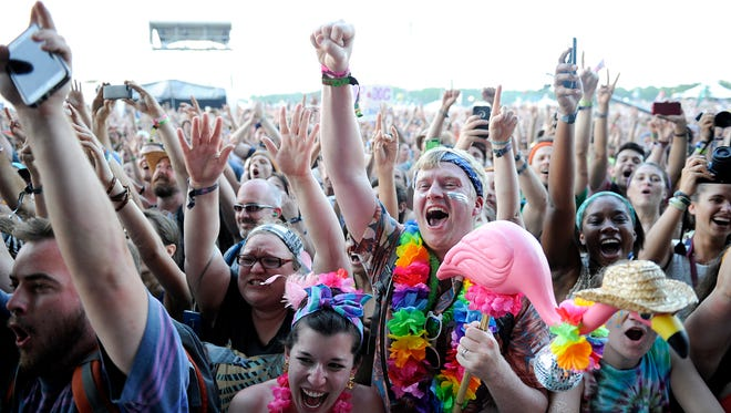 In this file photo: Alabama Shakes fans Carly and Scott Pierson,center, cheer while the band performs Bonnaroo Music and Art Festival on Friday June 12, 2015.