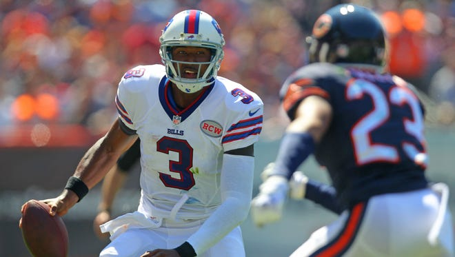 Bills quarterback EJ Manuel (3) runs away from Chicago Bears cornerback Kyle Fuller (23) during the first quarter of their Week 1 game at Soldier Field