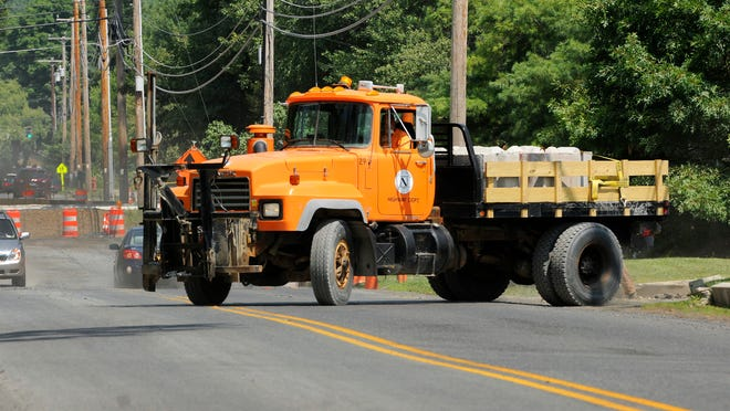 A Town of LaGrange Highway Department truck leaves the yard Tuesday on Stringham Road.