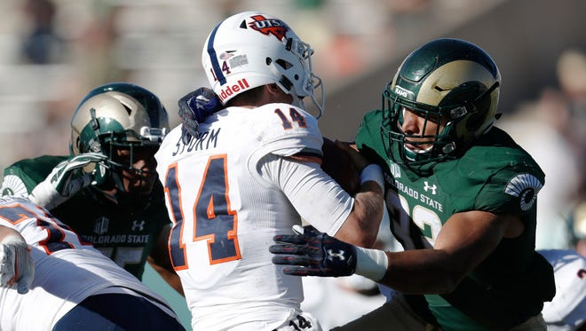 Linebacker Kevin Davis, one of 37 player from Colorado on CSU's football team, sacks Texas-San Antonio quarterback Dalton Sturm during a Sept. 10 game at Hughes Stadium. Davis said he and his teammates are determined to keep the Bronze Boot for a fourth straight year by beating Wyoming in the Border War on Saturday.