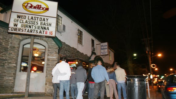 A line forms outside the old Stone Balloon Tavern and