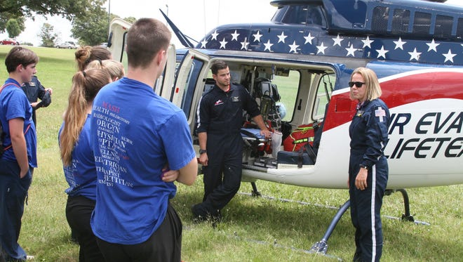 Air Evac Lifeteam flight nurse Zack Lovell (left) of Branson, Mo., and flight paramedic Hannah Rae of Eureka Springs, speak to students participating in the Arkansas State University-Mountain Home's MASH Camp.