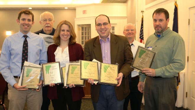 Burlington Free Press staff members Austin Danforth (front row from left), April Burbank, Adam Silverman  and Ryan Mercer are joined by Mike Donoghue (back row left), executive director of the Vermont Press Association and a former Free Press reporter, and former VPA President John Flowers on Thursday, March 17, 2016, at the Capitol Plaza Hotel in Montpelier.