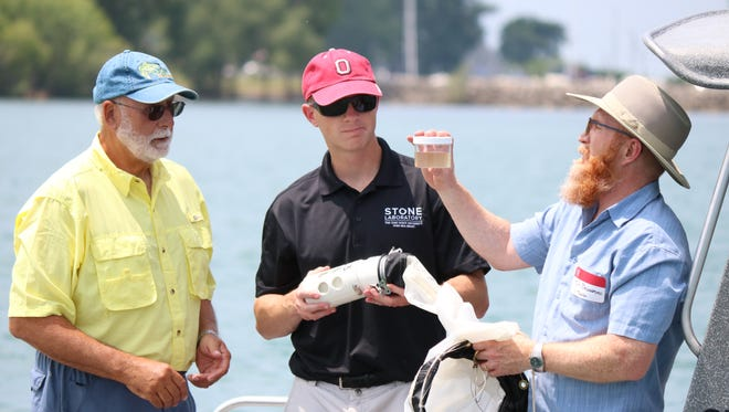 Researchers take water samples from Lake Erie following NOAA's harmful algal bloom forecast. From left: Dr. Bugs charter captain Dave Spangler, Stone Lab research coordinator Justin Chaffin and professor Tom Bridgeman, University of Toledo.