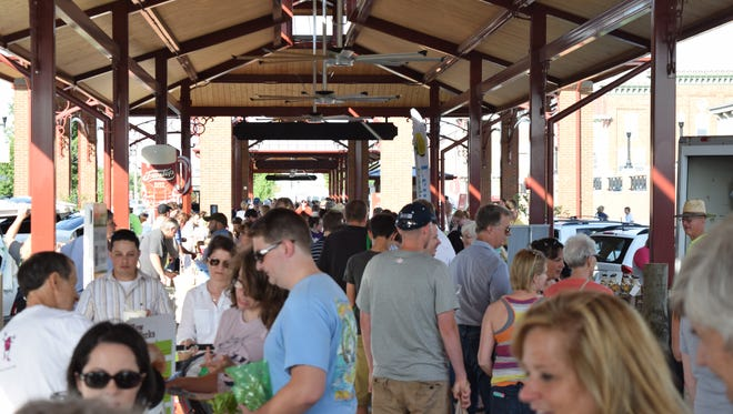 Large crowds came to the Canal Market District farmers market in downtown Newark in its initial year.