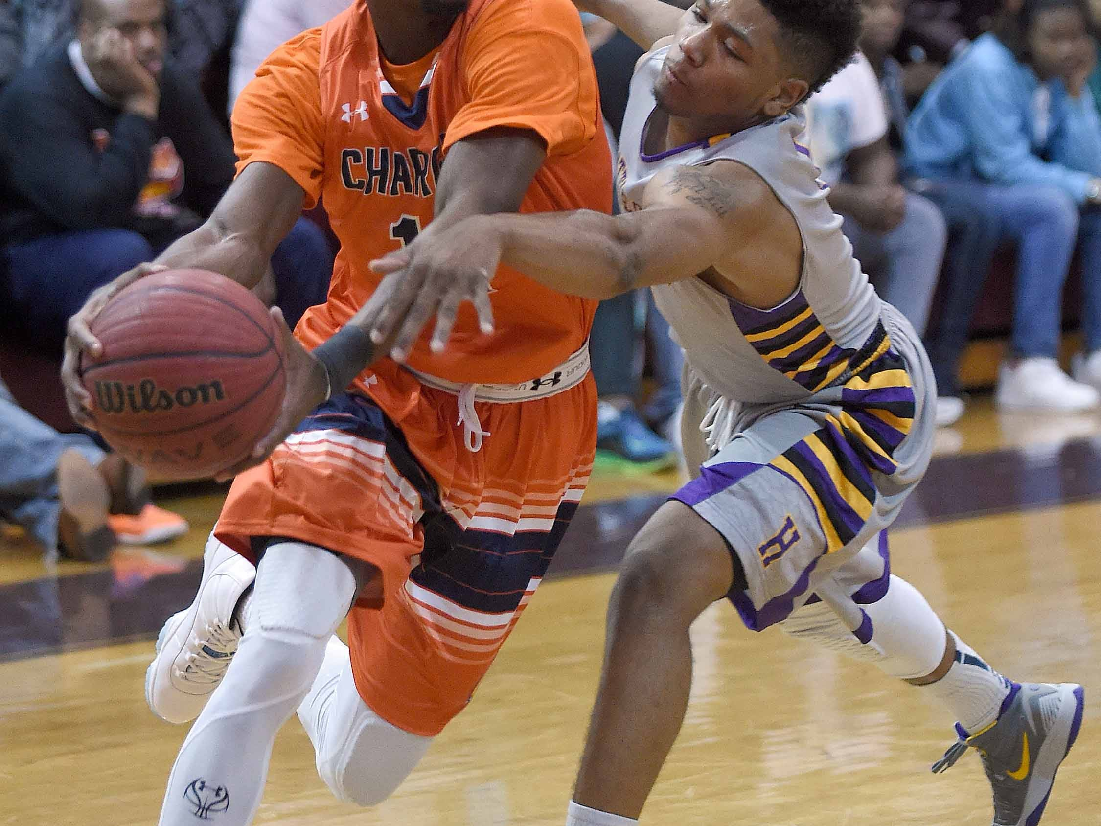 Callaway's Malik Newman (14) drives against Hattiesburg's Tristin Walley on Monday, January 19, 2015, at Lanier High School. Newman had 32 of his 42 points in the first half.