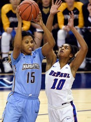 MU guard Amani Wilborn grabs a rebound against DePaul