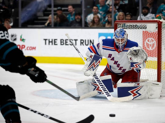 New York Rangers' goalie Alexandar Georgiev, right, watches a shot from San Jose Sharks' Timo Meier (28) in the first period of an NHL hockey game Thursday, Dec. 12, 2019, in San Jose, Calif. (AP Photo/Ben Margot)
