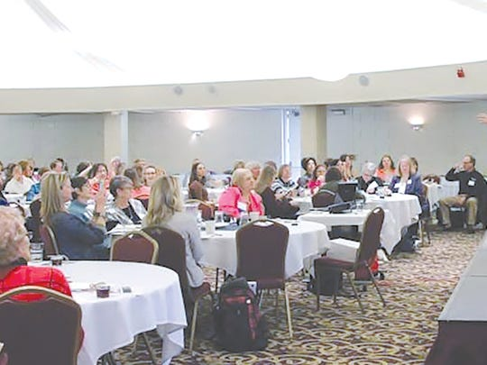 Farm Women's Symposium's featured speaker Jolene Brown addresses the audience.