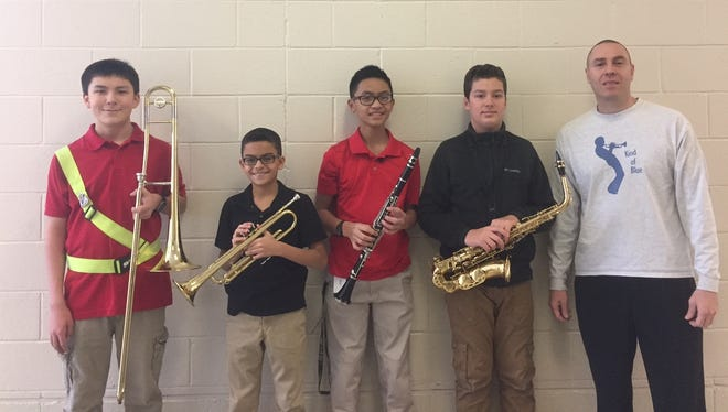 (From left) Veterans Memorial School Band members, Jonathan Choo, Adrian Ferrer, Rodrick-Josh Zapanta and Timothy Letushko, who qualified to perform with the All South Jersey Junior High Band, are pictured with school band director Ed Zatzariny.