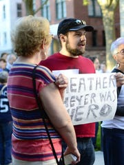 Brian Boone of Winooski holds a sign on Sunday, Aug. 13, 2017, bearing the name of the woman who was killed after a car drove into a group of protesters in Charlottesville, Virginia. Boone attended a speak-out and vigil in City Hall Park in Burlington to honor her and other victims of the violence.