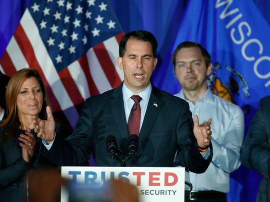 Wisconsin Gov. Scott Walker speaks at a Republican presidential candidate Sen. Ted Cruz, R-Texas, primary night campaign event, Tuesday, April 5, 2016, in Milwaukee. (AP Photo/Paul Sancya)