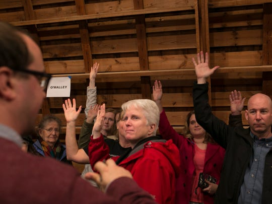 Precinct leaders count votes during the Democratic presidential caucus at Simpson Barn in Johnston Monday, February 1, 2016.